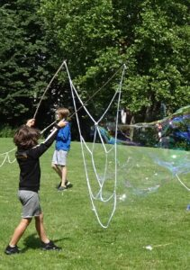 A child making giant bubbles